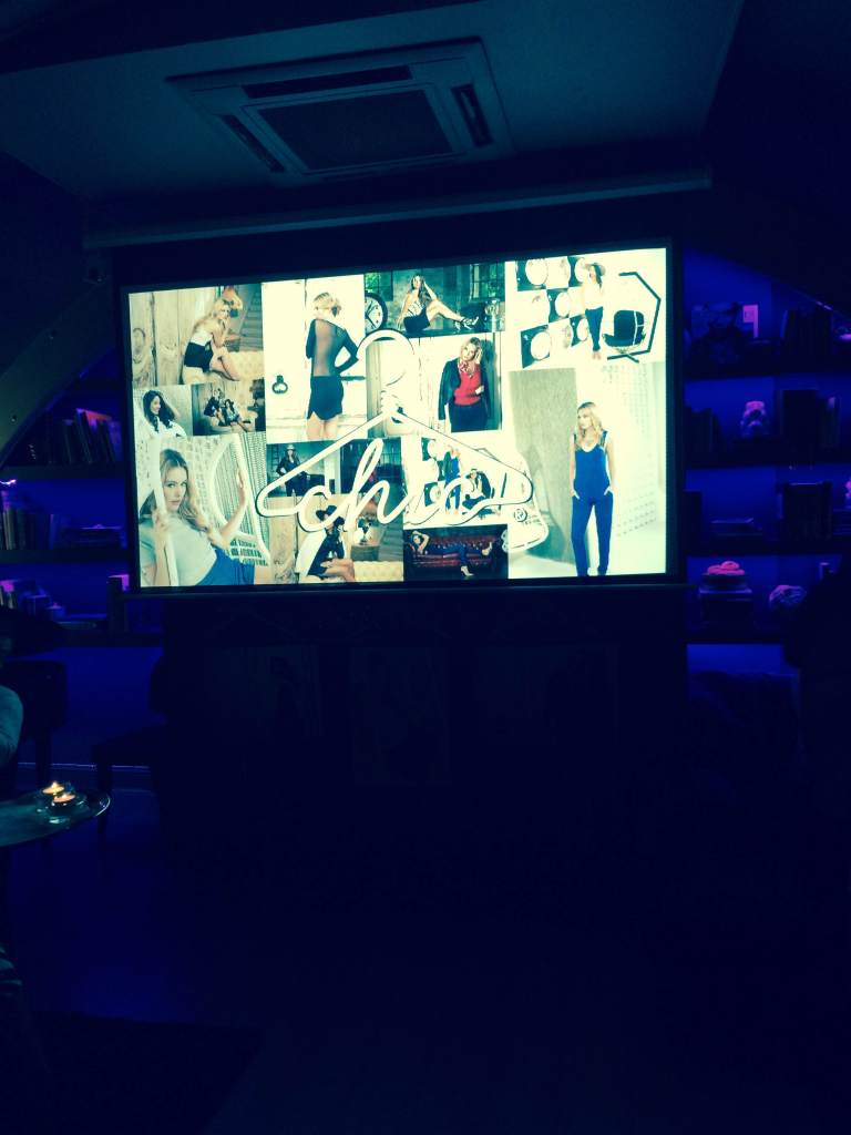 The photo shoot was shown on a large screen in the bar