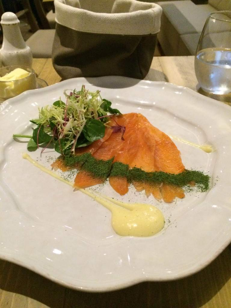 Salmon with lemon curd and dried parsley to start